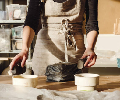 Potter in her studio working with clay